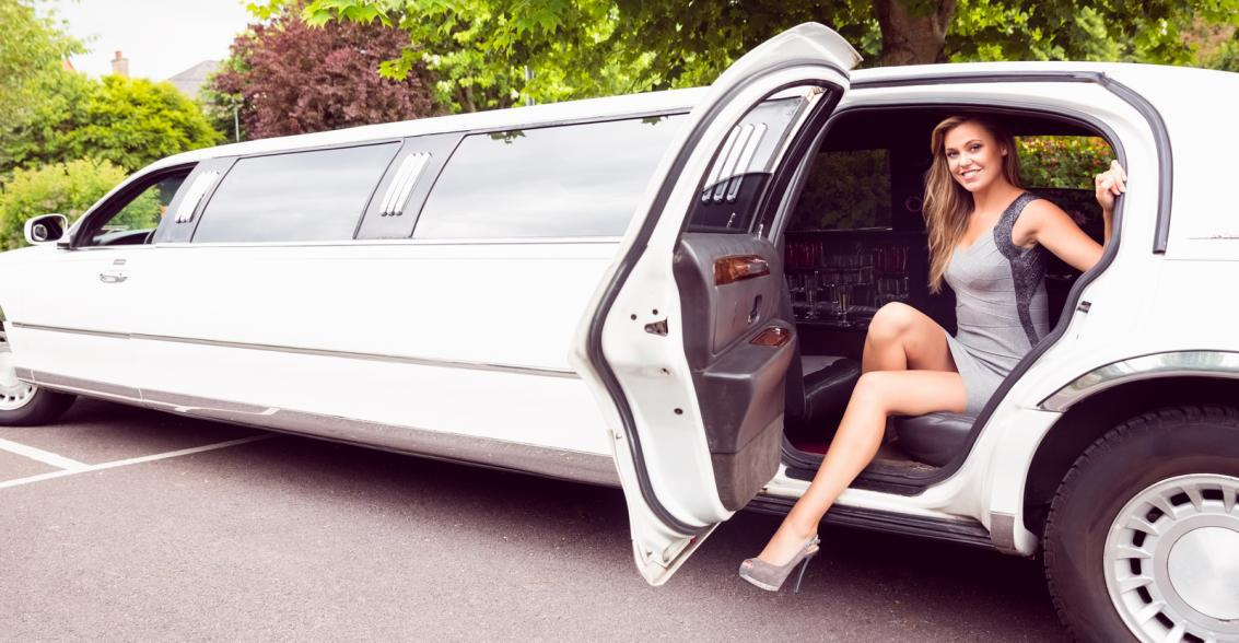 stepping out of limousine
